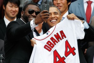 "WASHINGTON, DC - APRIL 01: Boston Red Sox designated hitter David Ortiz (L) poses for a ""selfie"" with U.S. President Barack Obama during a ceremony on the South Lawn of the White House to honor the 2013 World Series Champion Boston Red Sox April 1, 2014 in Washington, DC. The Red Sox defeated the St. Louis Cardinals in the 2013 World Series.(Photo by Win McNamee/Getty Images)"